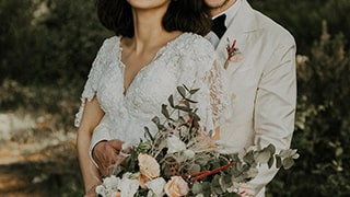 sina-demiral-sony-alpha-99II-bride-and-groom-just-married-standing-in-forest-smiling