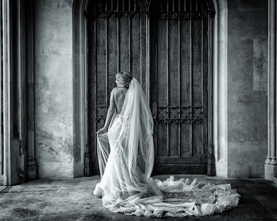 kate-hopewell-smith-sony-alpha-9-bride-prepares-to-walk-through-door-before-wedding